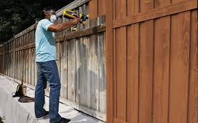 How To Paint A Wooden Fence With A Sprayer Wagner Diy Staining Wood Fence Fence Paint Colours Patio Fence