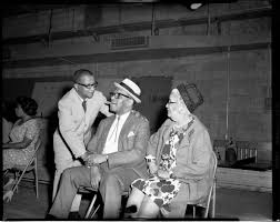 "Billy Strayhorn shaking hands with Willie ""The Lion"" Smith, with Janie Smith  on right, during Pittsburgh Jazz Festival jazz workshop, Civic Arena 