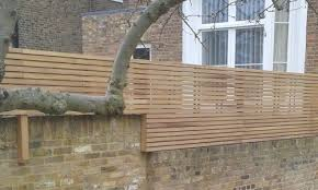 Top Of Wall Iroko Panels Brick Wall Gardens Trellis Fence Panels Trellis Fence