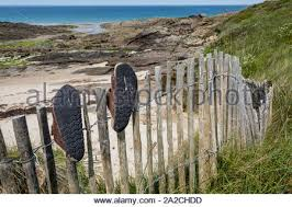 Shoes Hanging On Fence Stock Photo Alamy