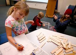 Photos: Bridge building part of Falls Library STEAM program