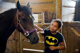 Horses helping kids — AP Images Spotlight