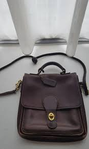 coach dark brown leather sling bag