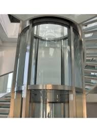 circular glass lifts made by gbh design