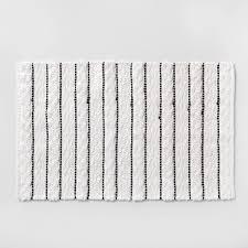 striped bath rug white black