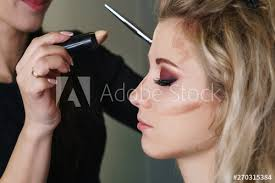 applying makeup on face