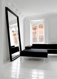 floor to wall matt black framed mirror