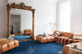 stylish home with oversized mirrors