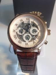 brown leather strap skeleton dial