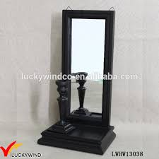 wall mounted black wooden mirror candle