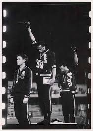 American athletes Tommie Smith and John Carlos protesting racial ...