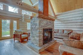 double sided stacked stone fireplace