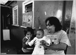 Everley St. Redfern...Jessica Glass 5, Lesley Hooky 9mnths and Roslyn...  News Photo - Getty Images