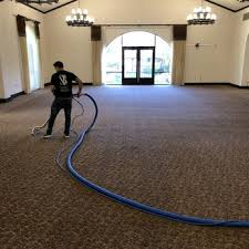 carpet cleaning technician hard at