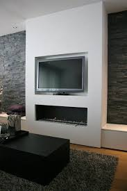 wall on one side tv above fireplace