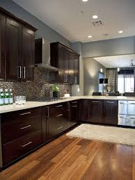 espresso cabinets and blue gray wall
