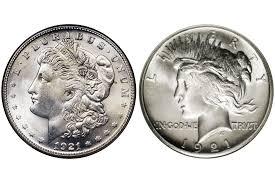 1921 two diffe silver dollar designs