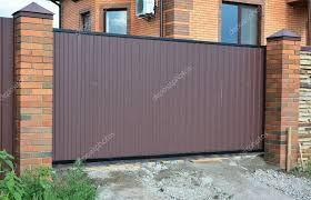 Pictures Modern Stainless Steel Gate Design Brick And Metal Fence With Metal Gate Of Modern Style Design Stock Photo C Thefutureis 129524880
