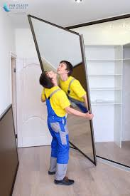how to glue a heavy mirror to the wall