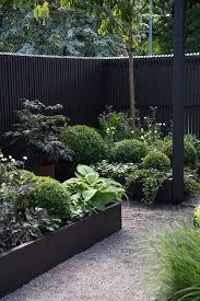 fencing in a lush green garden