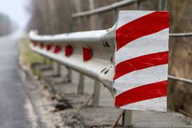 Premium Photo Red White Fence With Red Light Reflectors Along The Road