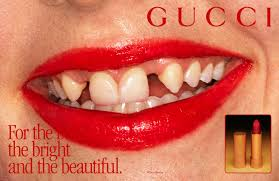 lipsticks and beauty ad with crooked teeth
