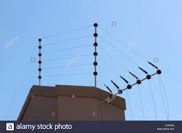 Electric Fence Against Blue Sky Atop Boundary Wall Stock Photo Alamy