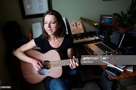 Folk singer and songwriter Meg Hutchinson plays one of her songs on... News  Photo - Getty Images
