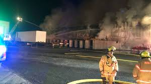 Crews battle 3-alarm fire at Anderson Hay & Grain warehouse in Aurora