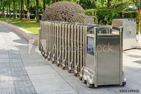 Automatic Stainless Steel Barrier Gate Or Folding Fence Gate For Protection In External Traffic That Blocks The Road Buy This Stock Photo And Explore Similar Images At Adobe Stock Adobe Stock