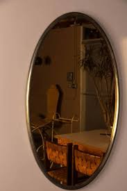 brass mirror with copper tinted glass
