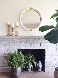 painted stone fireplace makeover the