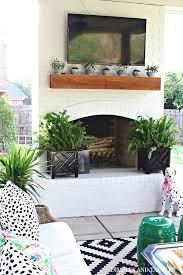 diy painted brick exterior fireplace
