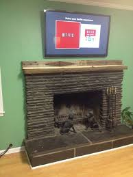 run tv cables above a fireplace tv