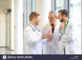 Doctors talking in corridor, Hospital Stock Photo: 168058857 - Alamy