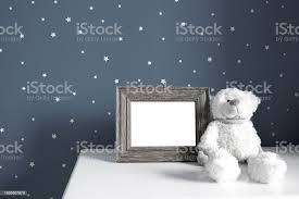 Teddy Bear And Photo Border In Kids Room Stock Photo Download Image Now Istock