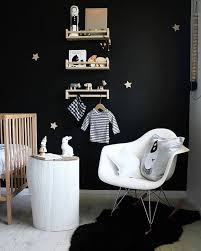 Wooden Bed White Chair Black Faux Fur Rug Wooden Floor Round Wooden Table Wooden Floating Shelves Toys Hanging Shirt Books Best Ways To Beautify Black Wall In Kids Room Home Decor Ikea
