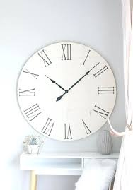 oversized wall clock over fireplace
