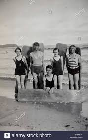 Digital Photograph - Two Girls & Three Men with Home Made Surf Boards,  Cowes beach, Phillip Island, 1934, Two girls and three men, in swimming  costumes and wooden surf boards at the