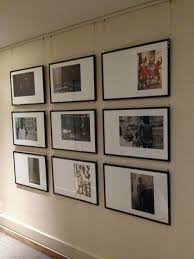 hanging art using a cable system