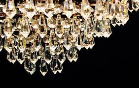 cleaning a crystal chandelier living
