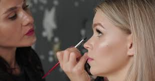 makeup artist apply with special stock