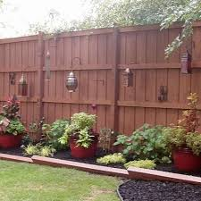 Reclaim Your Backyard With A Privacy Fence Privacy Fence Landscaping Backyard Patio Backyard