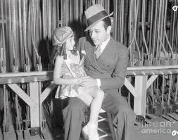 Actor George Raft With Young Girl by Bettmann