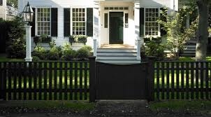 I Love The Black Front Fence And Gate Juxtaposed Against The White House Home Exterior House Paint Exterior Green Shutters White Exterior Paint