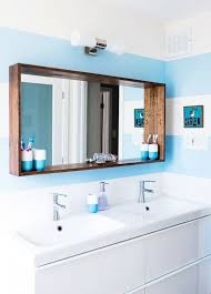 a bathroom mirror with a deep ledge for