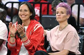 Megan Rapinoe Let Sue Bird Cut Her Hair With Long-Distance Help From  Stylist Riawna Capri | Allure