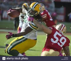 Green Bay Packers Aaron Ripkowski (L) is tackled by San Francisco ...