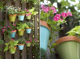 Spruce Up Your Fence With Hanging Pots Diy Planters Hanging Pots Fence Decor