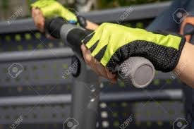 Person Wearing Protective Gloves Riding A Electric Scooter In Stock Photo Picture And Royalty Free Image Image 123835952